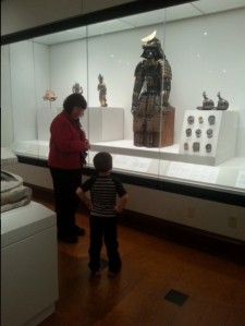 Adam contemplates a Japanese warrior's armor